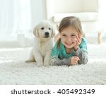 Stock photo the child with the dog lying on the mat at home 405492349