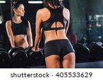 young woman choosing dumbbells...   Shutterstock . vector #405533629