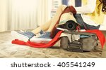 woman and suitcase  | Shutterstock . vector #405541249