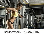 young fitness woman execute... | Shutterstock . vector #405576487