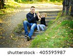 dad and young son sitting in... | Shutterstock . vector #405595987