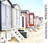 Beach Huts Or Houses And Blue...