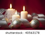 Christmas decoration with candles and ribbons / red and silver - stock photo