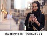 muslim woman messaging on a... | Shutterstock . vector #405635731