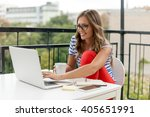 young woman with laptop | Shutterstock . vector #405651991