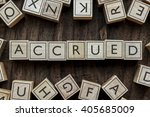 Small photo of the word of ACCRUED on building blocks concept