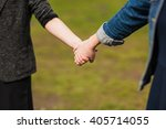 hands of young people in the... | Shutterstock . vector #405714055