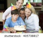 a family celebrating their son... | Shutterstock . vector #405738817