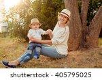 slender beautiful blonde mom in ...   Shutterstock . vector #405795025