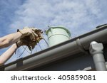 cleaning the home gutters... | Shutterstock . vector #405859081