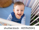 baby boy sitting in the crib | Shutterstock . vector #405965041