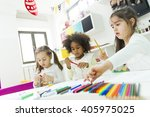 little girls drawing and... | Shutterstock . vector #405975025