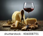 cheese and red wine on wooden... | Shutterstock . vector #406008751
