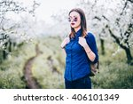 young woman walking in nature ... | Shutterstock . vector #406101349