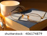 Glasses On An Old Book On A...