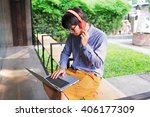 asian man using laptop out... | Shutterstock . vector #406177309