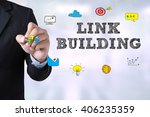 Small photo of LINK BUILDING Businessman drawing Landing Page on blurred abstract background
