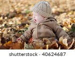 a cute little baby in the park   Shutterstock . vector #40624687