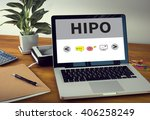 hipo laptop on table. warm tone | Shutterstock . vector #406258249