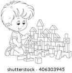 Little Boy Constructing A Toy...
