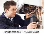 male plumber working on central ... | Shutterstock . vector #406319605