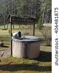 old water well with bucket in... | Shutterstock . vector #406481875