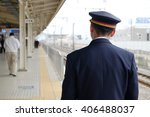 train conductor on platform | Shutterstock . vector #406488037