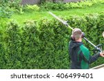 hedge trimming  works in a... | Shutterstock . vector #406499401