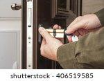 locksmith repairing the lock on ... | Shutterstock . vector #406519585