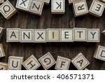 Small photo of the word of ANXIETY on building blocks concept