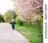 little baby boy in the blossom... | Shutterstock . vector #406572049