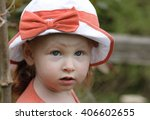 female toddler in the garden... | Shutterstock . vector #406602655