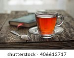 hot cup of tea with a notebook... | Shutterstock . vector #406612717
