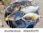 Small photo of The Thailand style burn or adust grilled fishes in the charcoal grill.