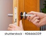 handyman repairing a door handle | Shutterstock . vector #406666339