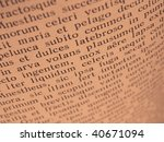 Small photo of warm toned open book page with ancient latin text of Aeneid by Virgil