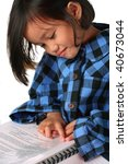 little asian girl reading a document - stock photo