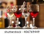 White Wine Pouring Into Wine...