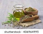 hemp oil n a glass jar and hemp ... | Shutterstock . vector #406964995
