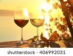 wine against vineyards in... | Shutterstock . vector #406992031