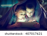 two kids using tablet pc under... | Shutterstock . vector #407017621