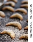 Small photo of Almond Crescent cookies on dark moody background, selective focus