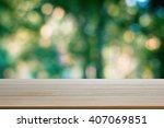 wood table top on bokeh... | Shutterstock . vector #407069851