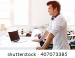 young man standing in creative... | Shutterstock . vector #407073385