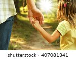 the parent holds the hand of a... | Shutterstock . vector #407081341