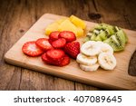 Sliced Fruit On A Cutting Boar...