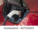 electric car charging with... | Shutterstock . vector #407104021