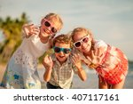 happy children playing on the... | Shutterstock . vector #407117161
