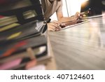 designer hand working with... | Shutterstock . vector #407124601