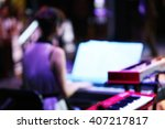 musician playing the piano at... | Shutterstock . vector #407217817